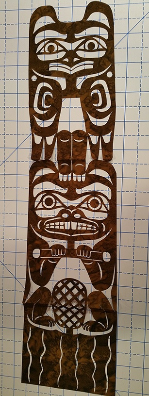 I even bought a laser cut fabric totem pole to put on my finished quilt. (6 and 7)